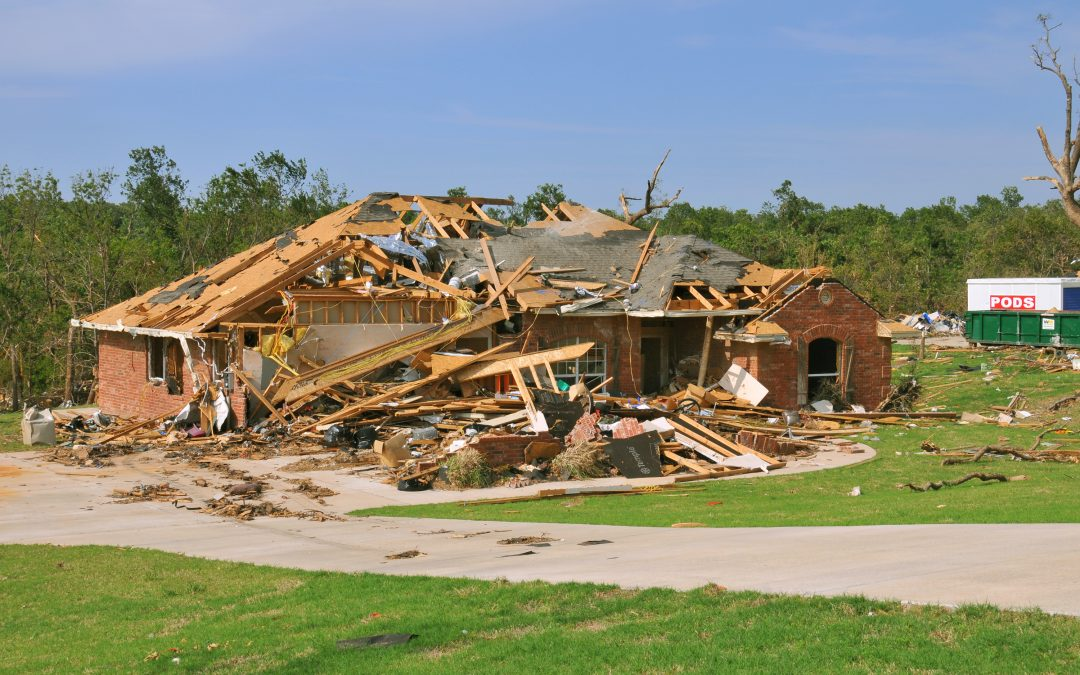 A home torn to pieces with the roof and internal structure exposed.